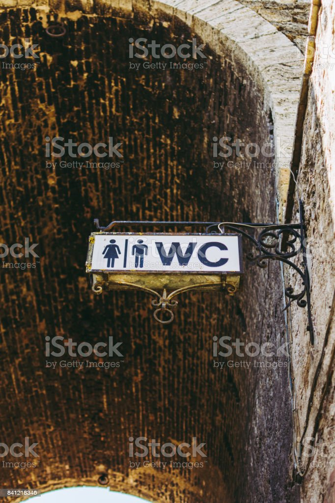 Public Toilet, Medieval Sign in Tuscany, Italy stock photo