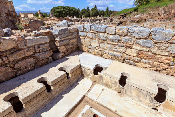 Public Toilet Scholastica Baths Ephesus Turkey Public Toilet Scholastica Baths Ephesus Turkey celsus library stock pictures, royalty-free photos & images