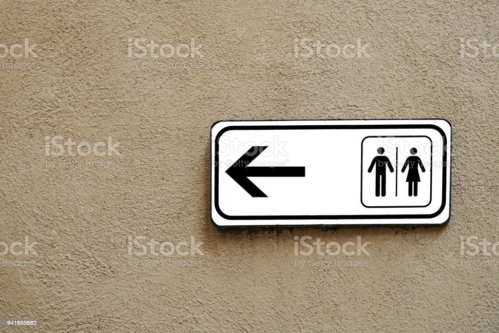public toilet sign on a wall stock photo