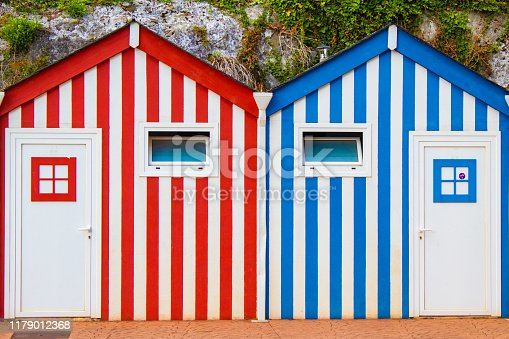Two public toilets installed in colorful wooden booths in Ortigueira, Galicia (Spain)