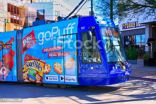 Public transport tram covered in advertising in downtown Tucson AZ