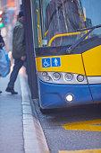 Public transportation / bus in urban surroundings on the street.