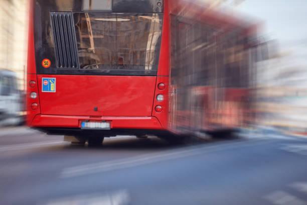 Public transportation / bus in urban surroundings on the street. stock photo