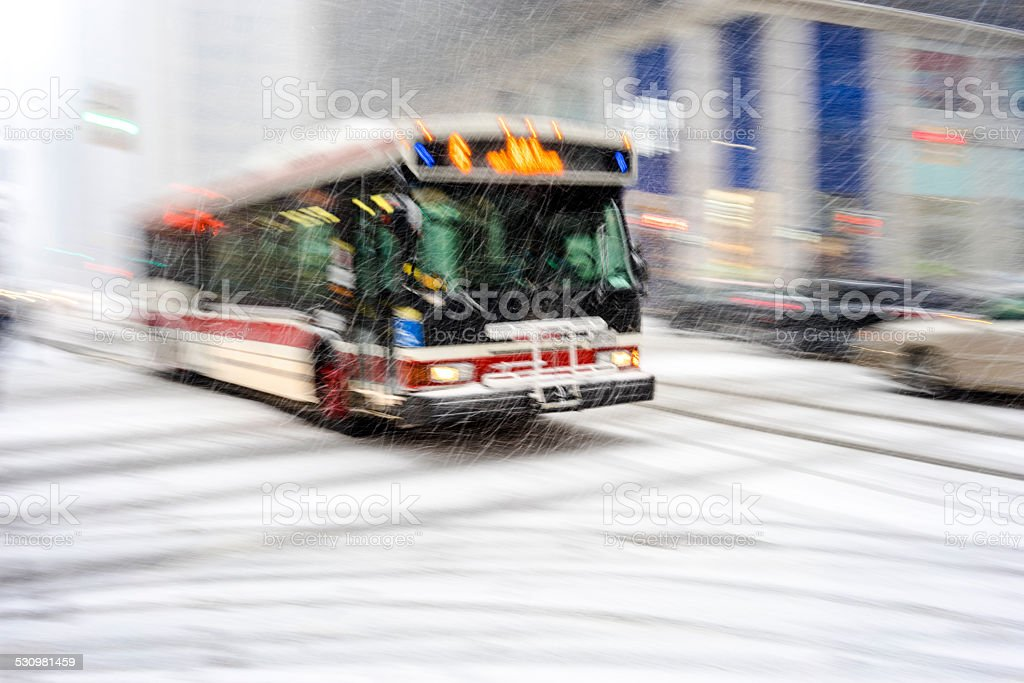 Public transportation in the snowstorm stock photo
