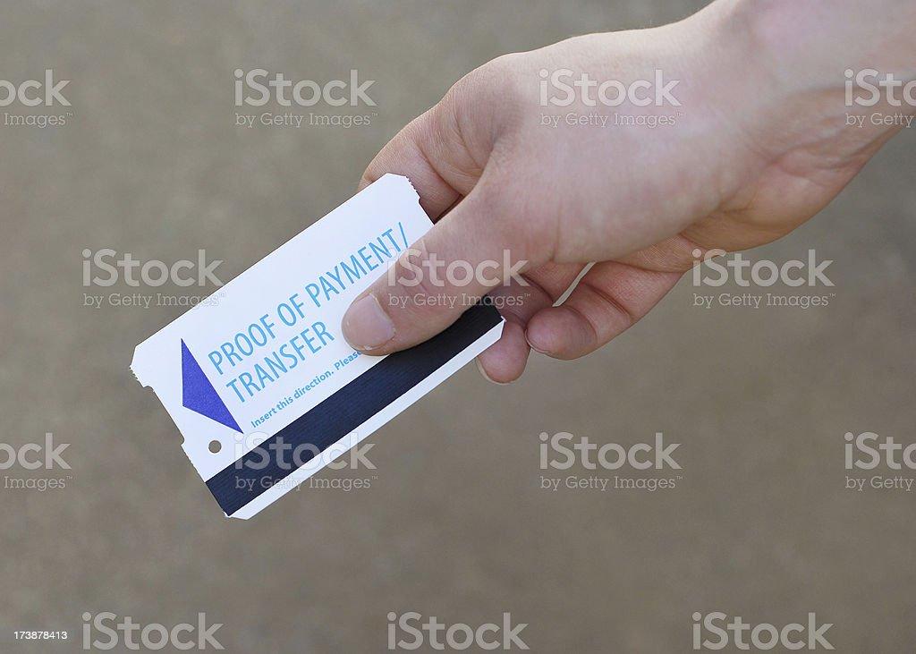 Public Transportation ticket in hand stock photo