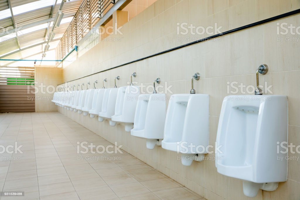 Public Urinate For Men Restroom With Ceramic Urinal Stock Photo ...