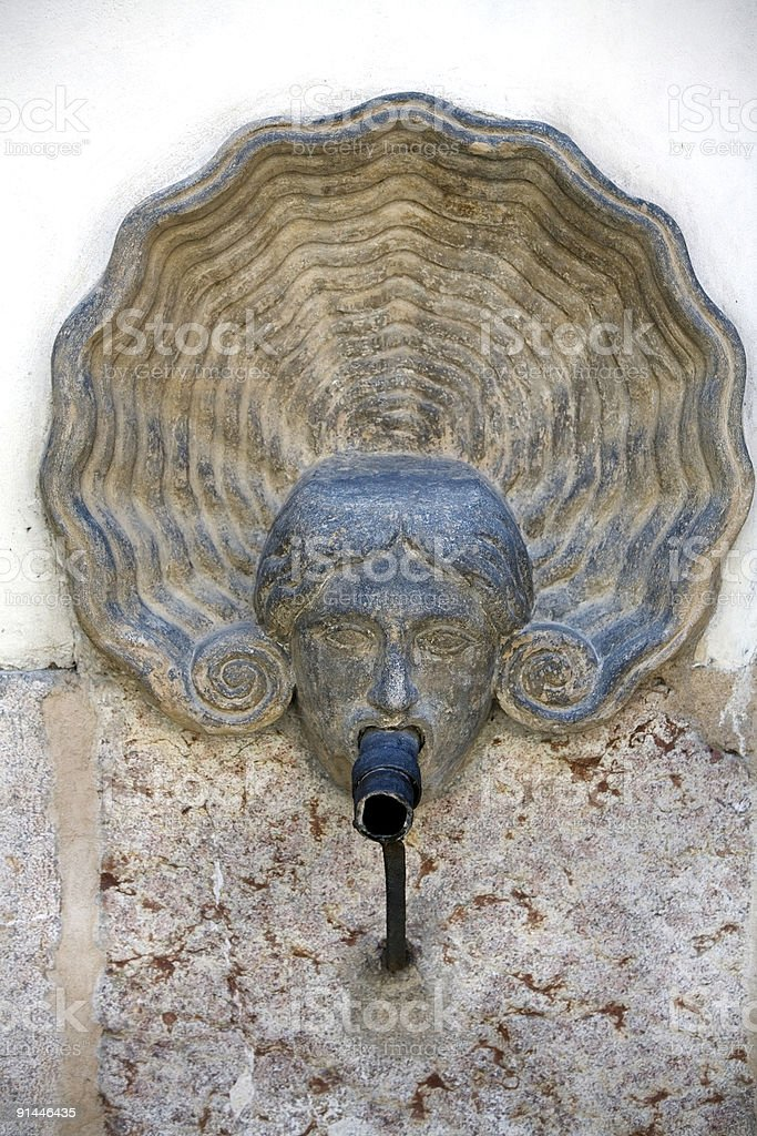 Public Water Fountain Human Face Europe royalty-free stock photo