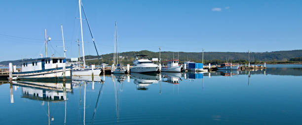 Public waterfront maritime marina/dock with boats. stock photo