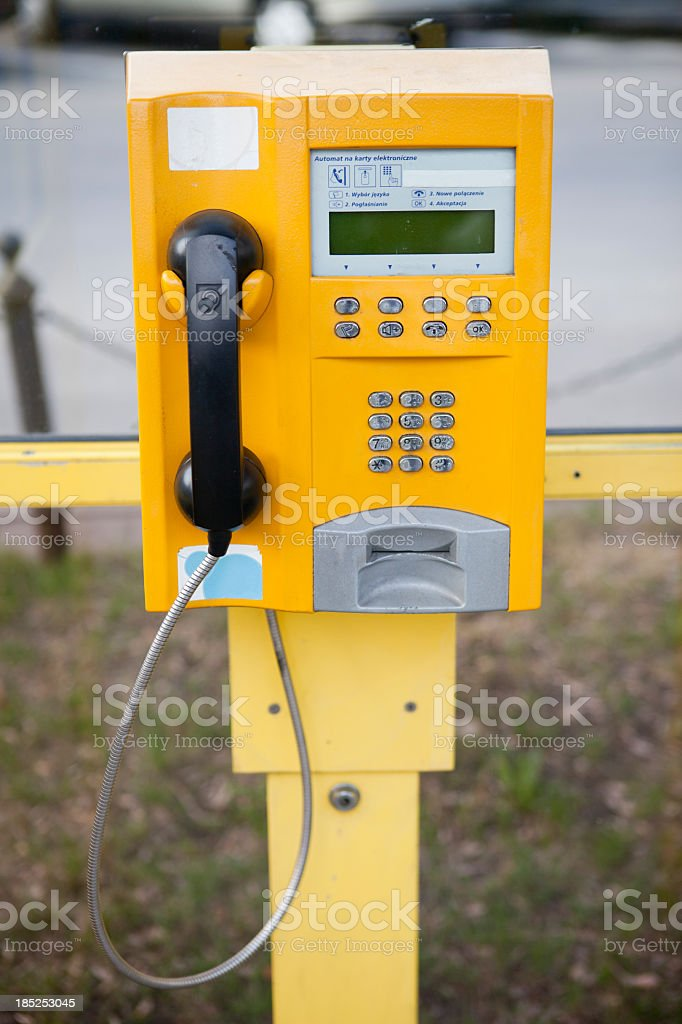 Public, yellow pay telephone royalty-free stock photo