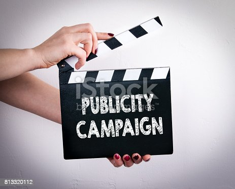 842214626istockphoto Publicity Campaign. Female hands holding movie clapper 813320112