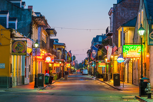 istock Pubs and bars with neon lights in the French Quarter, New Orleans 868971052