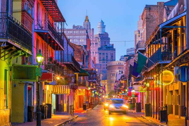 pubs and bars with neon lights in the french quarter, new orleans - mardi gras stock photos and pictures