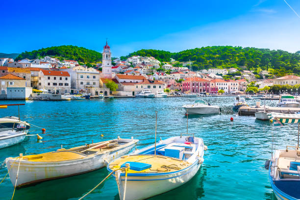 Pucisca Brac summer view. Seafront scenery of small mediterranean village Pucisca on Island Brac, tourist summer resort in Croatia, Europe. croatian culture stock pictures, royalty-free photos & images