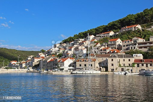 Pucisca is small town on Island of Brac, popular touristic destination on Adriatic sea, Croatia. The city famous from the sandstone from which the White House was built in Washington. Local buildings are built from this sandstone.