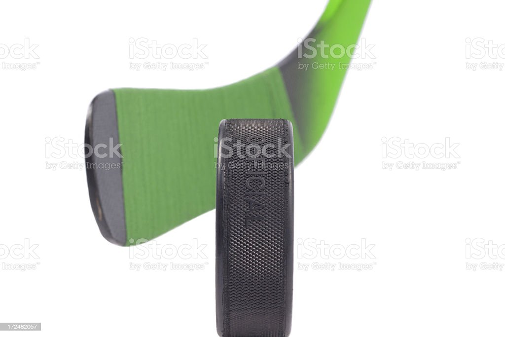 Puck and hockey stick royalty-free stock photo