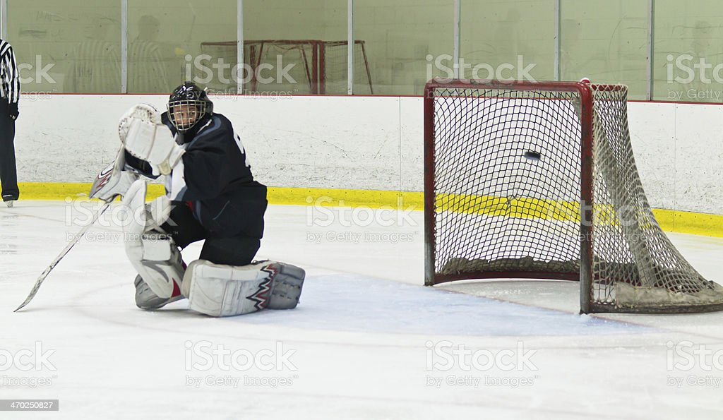 Puck gets past the goalie during an ice hockey game stock photo