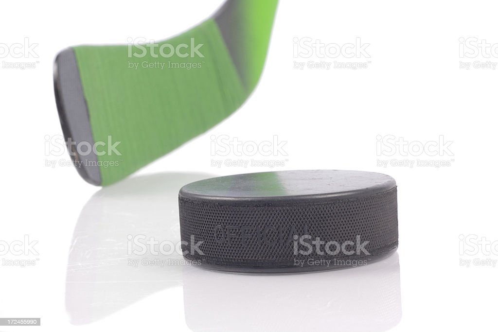 Puck on ice and hockey stick royalty-free stock photo