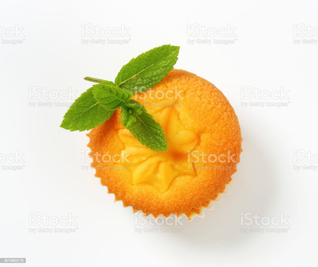 Pudding filled lemon cupcake stock photo