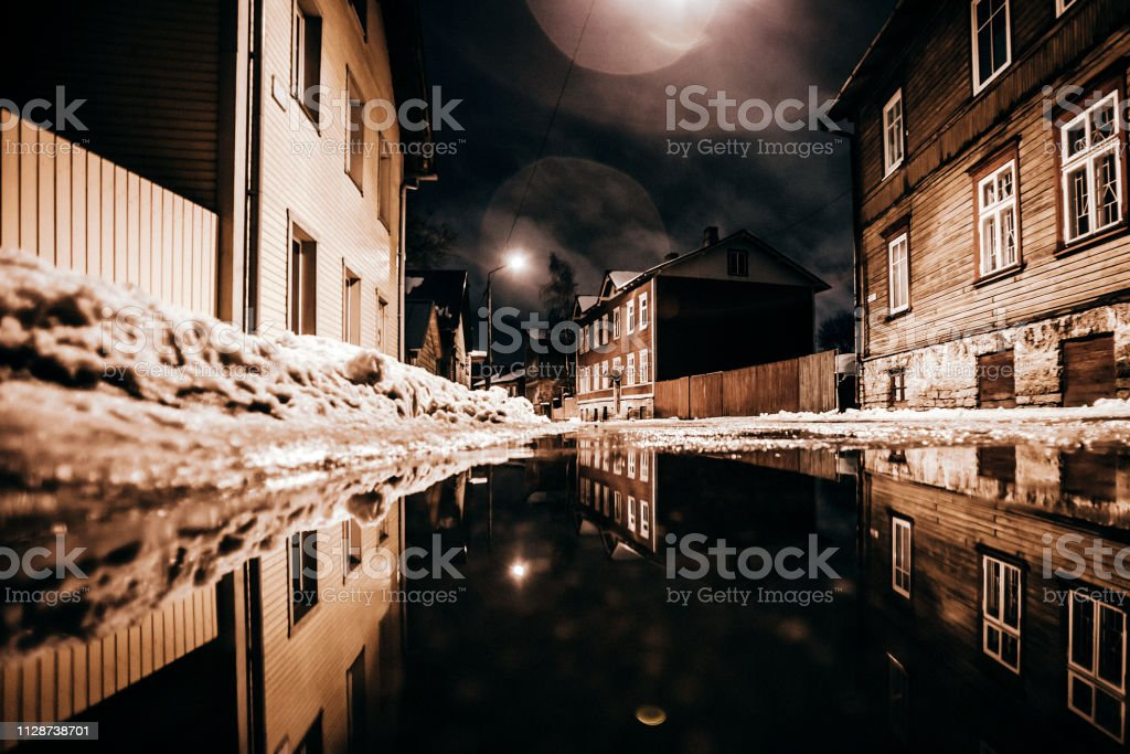 Puddle reflection - Tallinn, Estonia stock photo