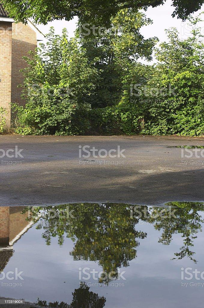 Puddle reflection unyielding tarmacadam royalty-free stock photo