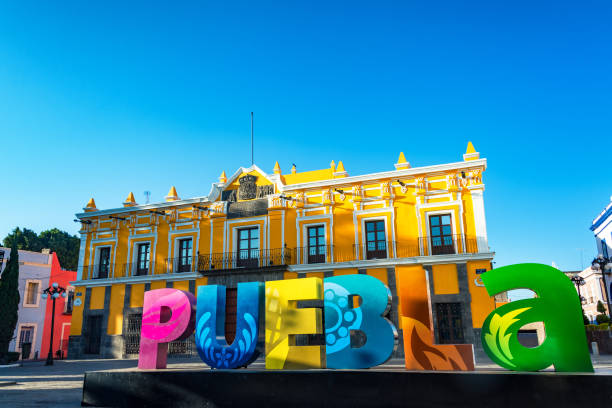 Puebla Sign and Theater Puebla sign and historic theater in Puebla, Mexico puebla state stock pictures, royalty-free photos & images
