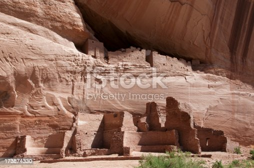 Arizona pueblo ruins with cliff buildings in background