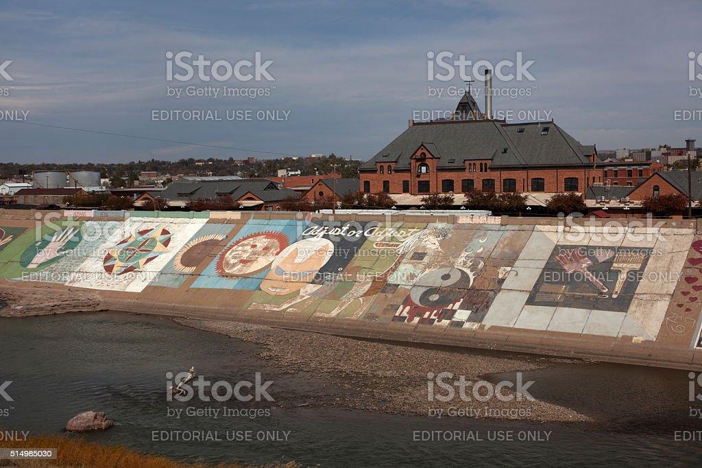 Pueblo Union Station with levee murals along Arkansas River Colorado stock photo