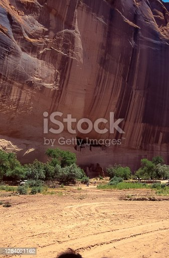 The remains of Anasazi people's villages can be seen in the cracks in the vertical walls that form Chelly Canyon on the Navajo Reservation in Arizona.