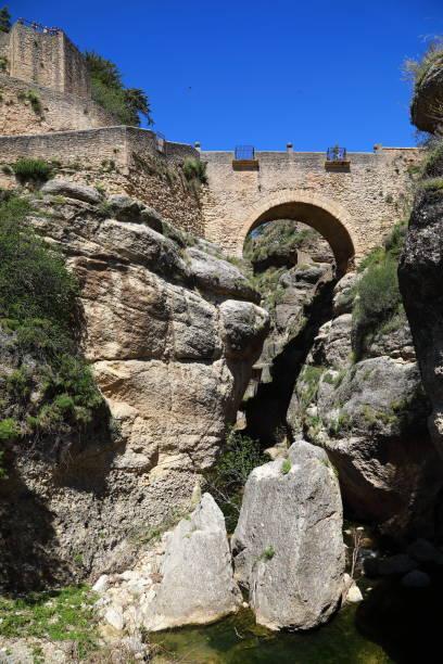 puente de san miguel bridge in ronda andalusia, spain - pejft stock photos and pictures