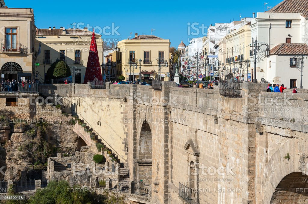 Puente Nuevo bridge and architecture of old town, one of the famous white villages in Andalusia, Spain stock photo