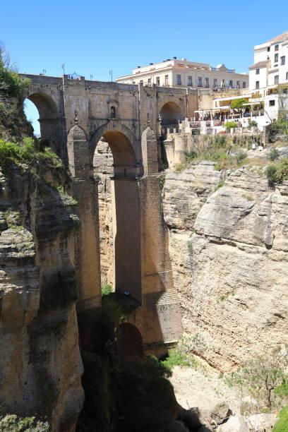 puente nuevo bridge in ronda andalusia, spain - pejft stock photos and pictures