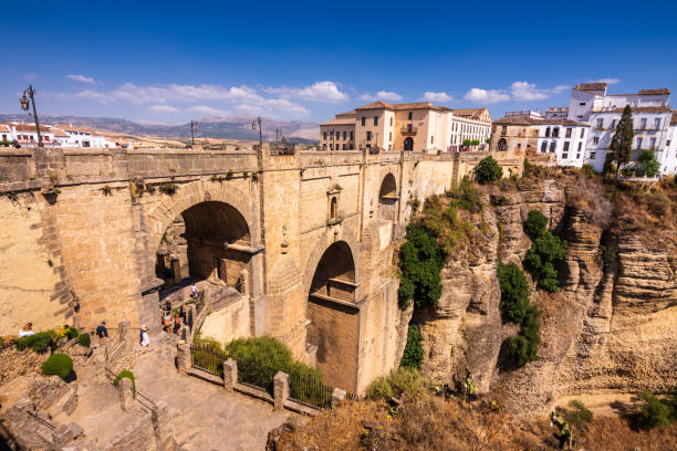 Puente Nuevo stone bridge and Pueblos Blancos in mountaintop town of Ronda in Spain stock photo