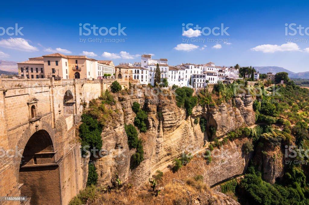 Puente Nuevo stone bridge and Pueblos Blancos on edge of El Tajo Gorge in mountaintop town of Ronda in Spain - Royalty-free Andalucian Sierra Nevada Stock Photo