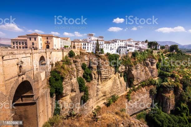 Puente Nuevo Stone Bridge And Pueblos Blancos On Edge Of El Tajo Gorge In Mountaintop Town Of Ronda In Spain Stock Photo - Download Image Now