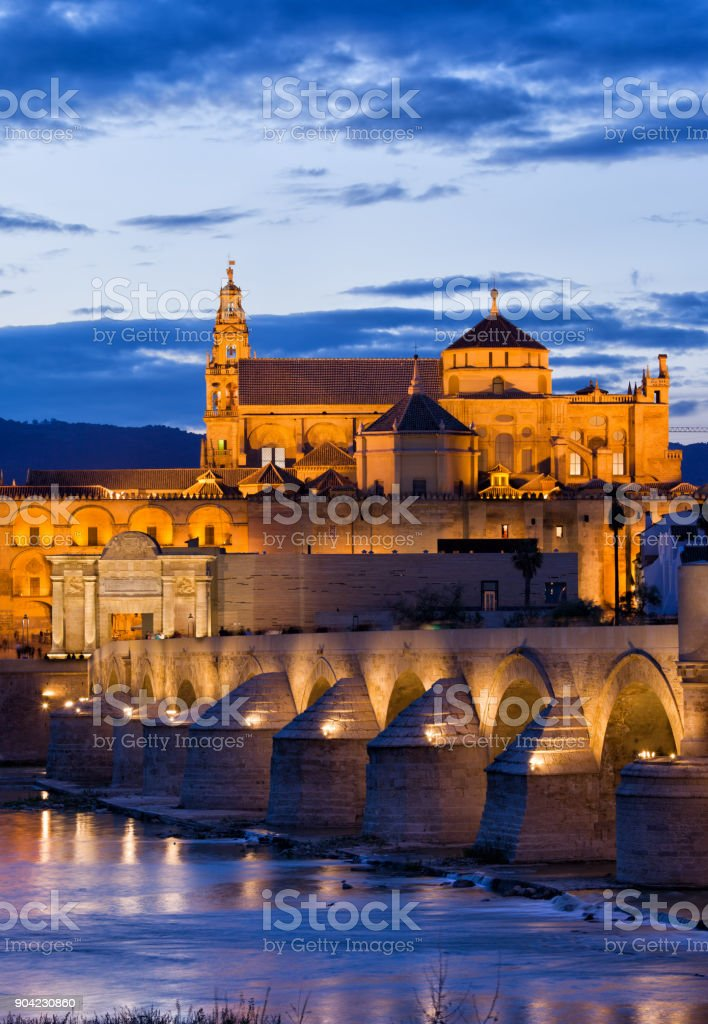 Puente Romano and Mezquita at Twilight in Cordoba stock photo