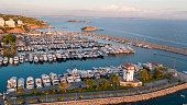 Aerial drone view of the stunning Mediterranean Yacht Harbour and marina of Puerto Portals, Mallorca, Spain, Balearic Islands during sunset hours.