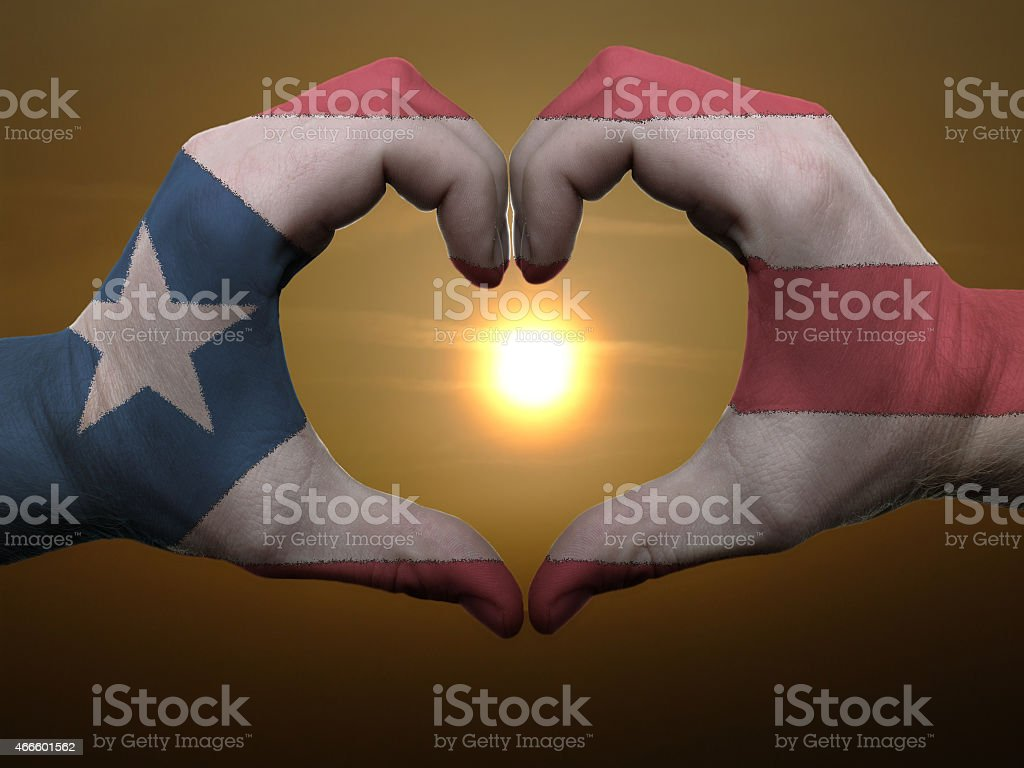 puerto rico flag heart and love gesture and sunset stock photo