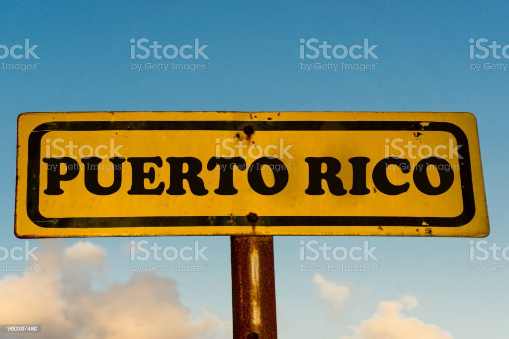 Puerto Rico state street on antique old yellow sign with blue sky at background, USA signal state series. stock photo