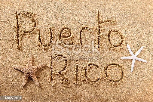 Puerto Rico beach word written in sand vacation concept