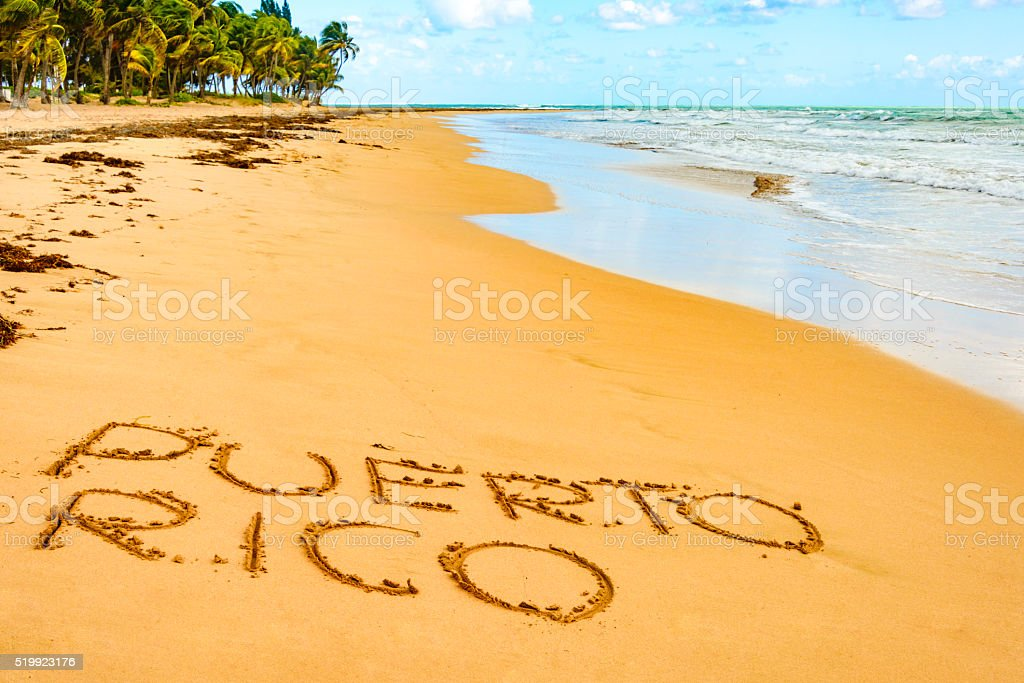 Puerto Rico written on one of its beautiful beaches stock photo