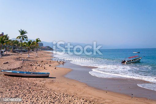 Empty Puerto Vallarta Beach with boat in the sand