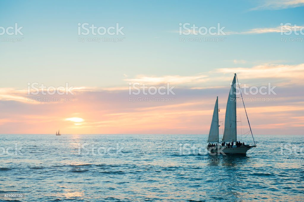 Puerto Vallarta Sailboat in Pacific Ocean at Sunset Mexico stock photo