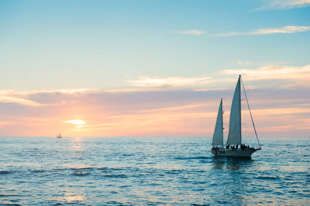 puerto vallarta sailboat in pacific ocean at sunset mexico - sail stock pictures, royalty-free photos & images