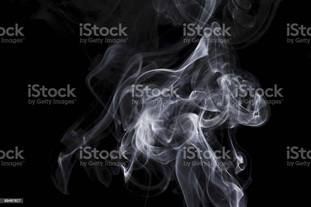 puff of aroma smoke on a dark background royalty-free stock photo