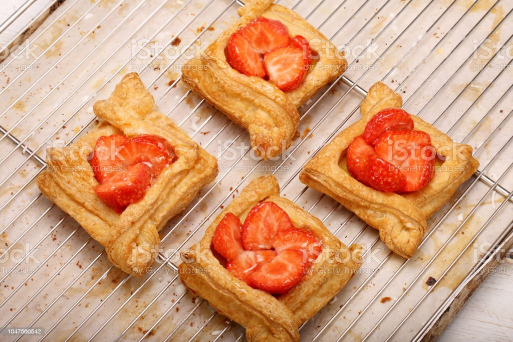 Puff pastry cake with strawberry in bakery stock photo