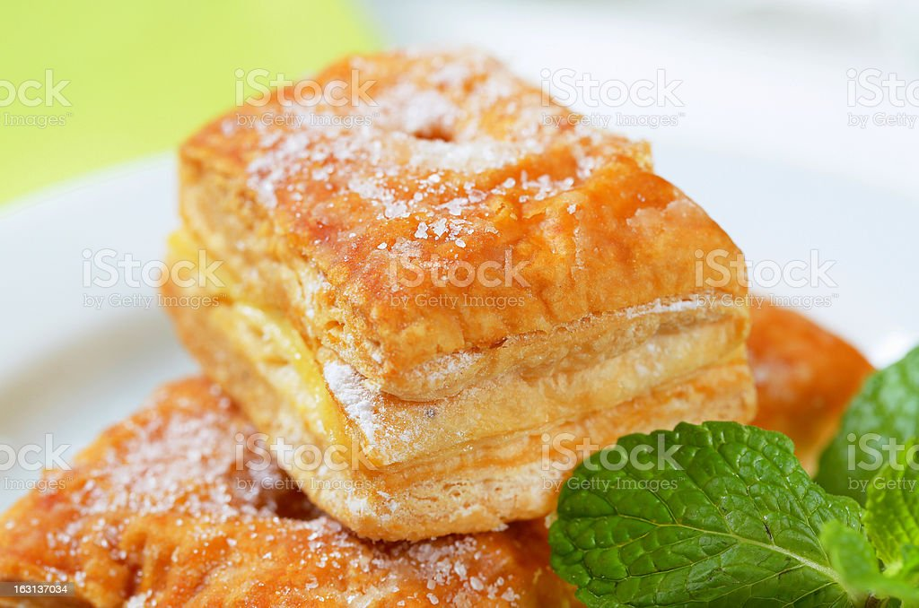 Puff pastry filled with pudding cream royalty-free stock photo