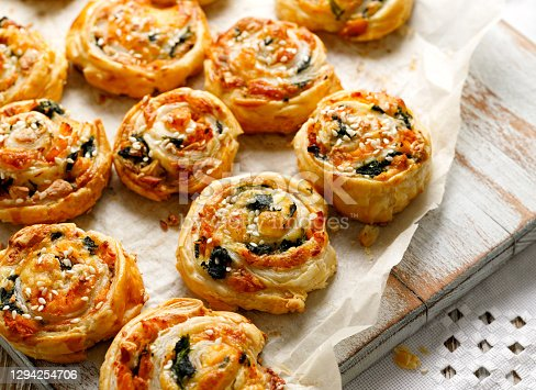 istock Puff Pastry Pinwheels stuffed with salmon, cheese and spinach on a wooden background 1294254706