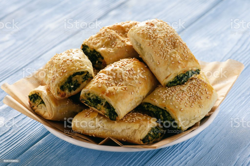 Puff pastry rolls  with spinach and ricotta. stock photo