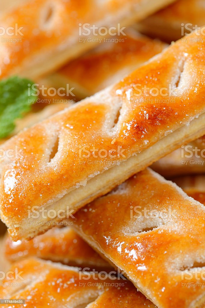 Puff pastry sticks on a cutting board royalty-free stock photo