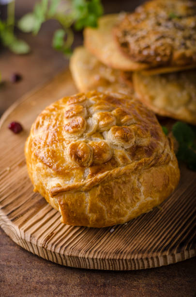 puff pastry stuffed by camembert - baked brie stock photos and pictures